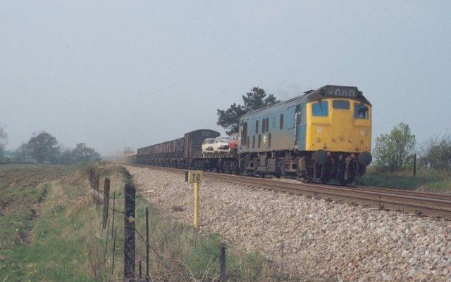 10/4/81:- 25056 heads a long mixed freight train westwards past Wadborough Crossing